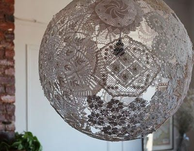 """Dunno where I would hang something like this but it is *awesome* and I found a site that gives step by step directions just by typing in """"how to make doily lamps"""". Check it out!"""