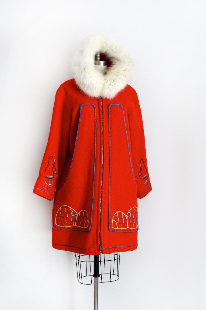 Absolutely stunning red wool coat from the 1960s handcrafted by Canadian Eskimos. This parka style jacket features embroidery of igloos and Inuit style people, a thick metal zip up the front, and a fur trimmed hood. **red is hard to photograph and may be a little bit different in person.  Label: Handcrafted by Canadian Eskimos Closure: metal zip up front Measurements:  Best Fit: up to xlarge  Bust: up to 42 Waist: up to 44 Hips: up to 48 Length: 37 Sleeve Length: 22  Condition: excellent…