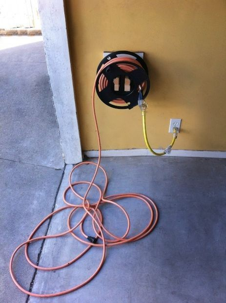 Extension Cord Winder Mount by thiswayhome -- Homemade extension cord winder mount constructed from MDF, wood, and drywall screws. Capable of accepting standard cord reels. http://www.homemadetools.net/homemade-extension-cord-winder-mount