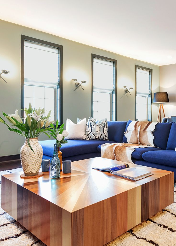 In This Mid Century Modern Living Room A Blue Sectional Sofa
