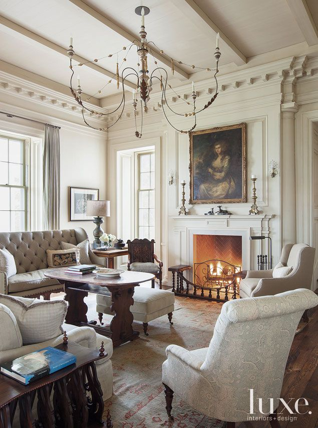 This homey great room sitting area boasts a tufted 19th-century Italian Regency canapé.