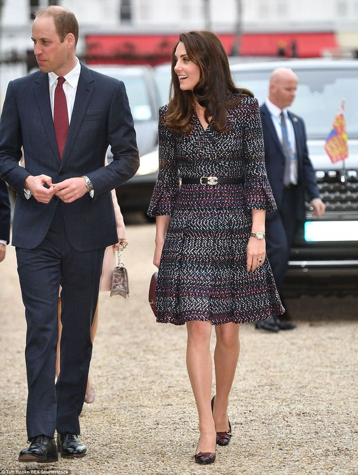 Stunning: Kate was wearing a chic Chanel suit - a choice bound to delight fashionistas - a...