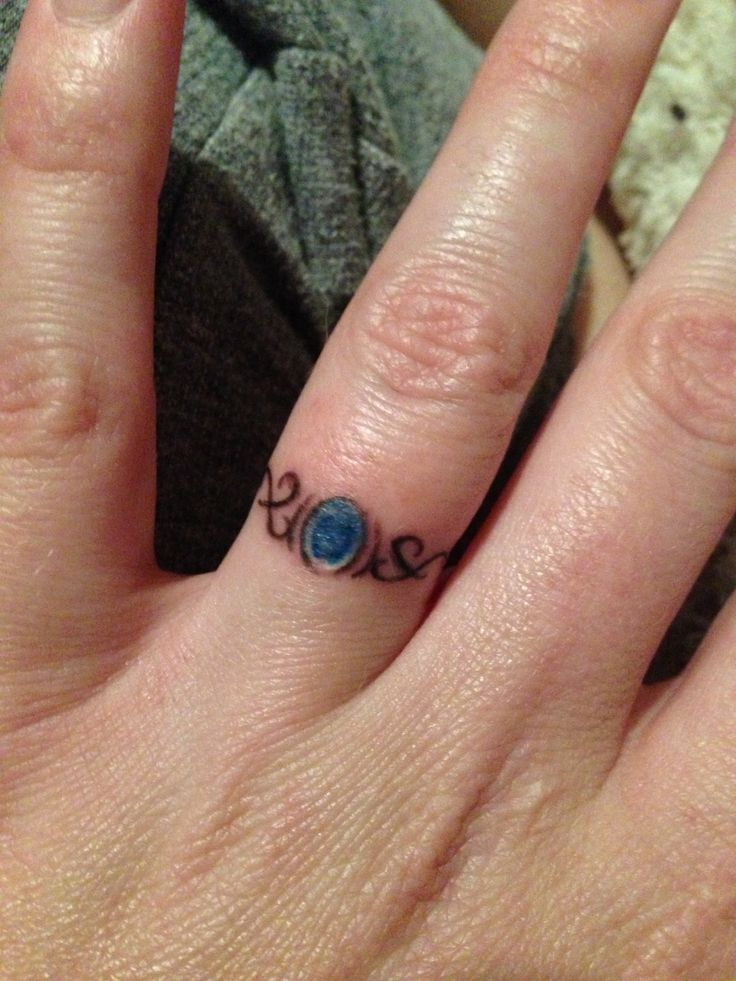 Wedding ring tattoo.