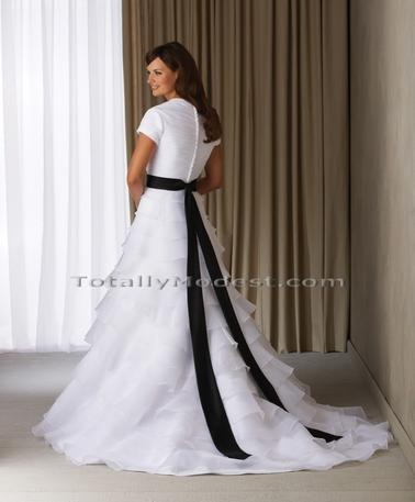 MODEST wedding dresses but with a teal ribbon.