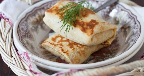 A blin , blintchik  or blintz  is a type of thin pancake.   Pancakes are considered one of the most popular dishes in Russian cuisine. The...