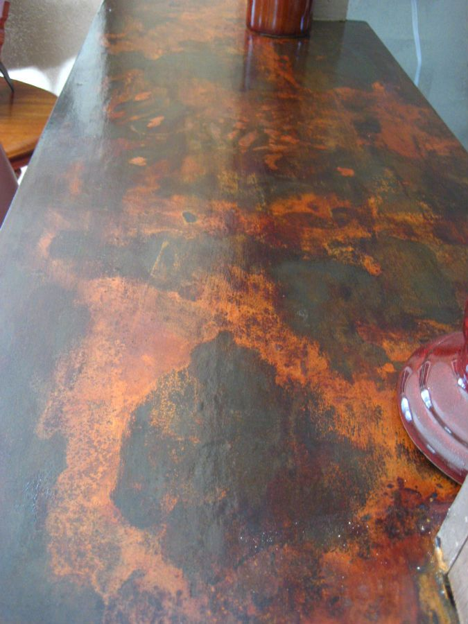 Decorative counter top resurfaced over old laminate using Modern Masters Metal Effects  Love the colors!