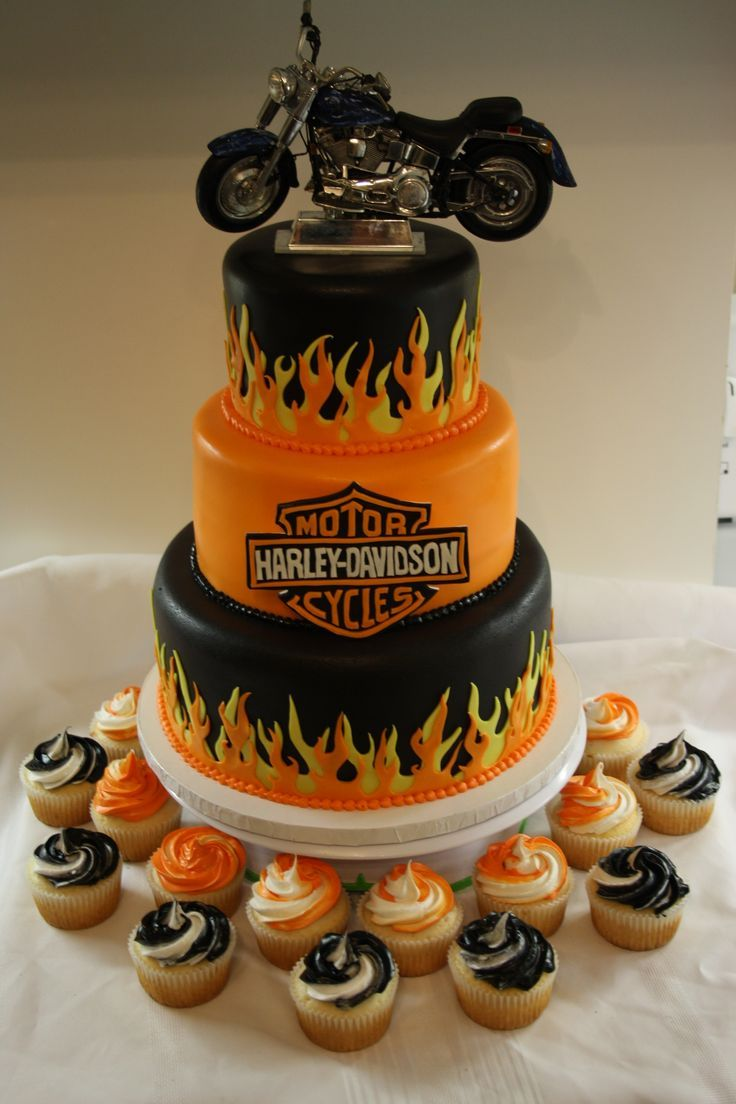Harley Davidson Cake - This cake was made for a 50th birthday party. The customer provided the bike on top which looks just like his bike. Everything else was hand made and edible.
