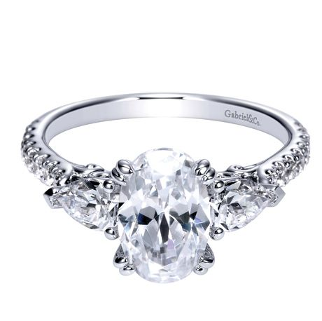 Oval Center With Pear Shaped Side Diamonds Create This