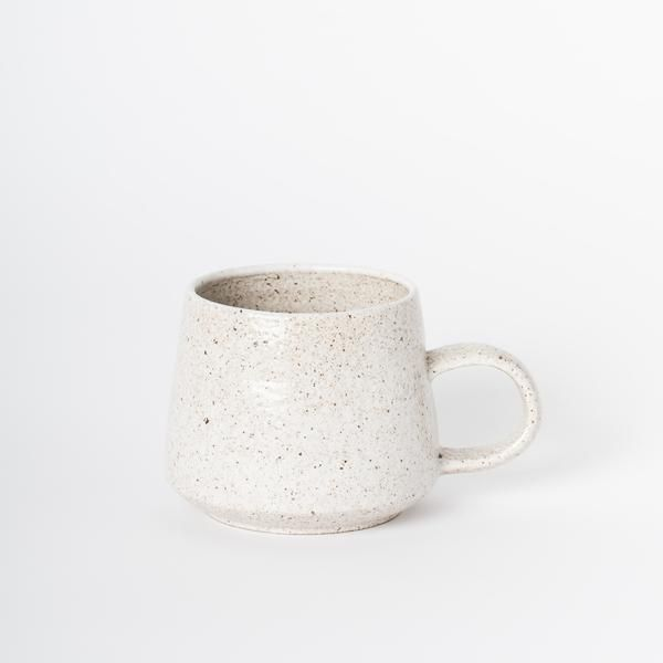 Steaming hot or frosty cold, drinks just taste best better in ceramic vessels. These hand-thrown stoneware mugs will have you quenched and happy in no time. Finished with a food-safe glaze that remind