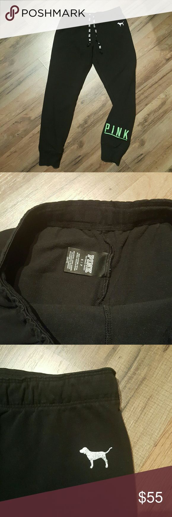 """VS PINK Black Gym Pants Black with neon green PINK logo on otter bottom left leg. Silver metallic PINK dog logo is semi cracked (pic 3) and well-loved. Drawstrings.  SIZE SMALL  WAIST 29"""" (unstretched) INSEAM 27.5""""  NO Trades  Open to offers. Use the offer button, comment offers will be ignored and NOT CONSIDERED.  BUNDLE DISCOUNT: 10% OFF FOR 2 OR MORE ITEMS. PINK Victoria's Secret Pants"""
