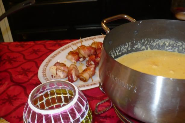 Cheese fondue! Courtesy of the Melting Pot! They shared this recipe on a morning show! I have to try this! With three kids going to melting pot just hasn't happend in a few years so I think one weekend when kids go to grammys house I will suprise my hubby with a fondue night!!!