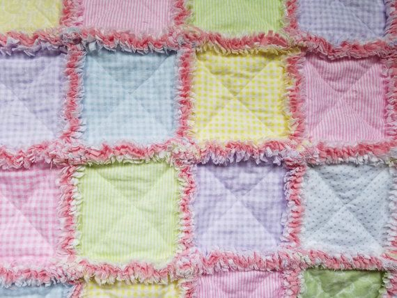 Pink green yellow blue and lavendar flannel rag quilt for