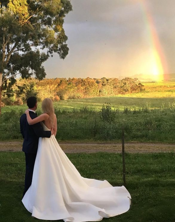 Romantic rainbow sunset over the mountains at Chateau Yering Hotel