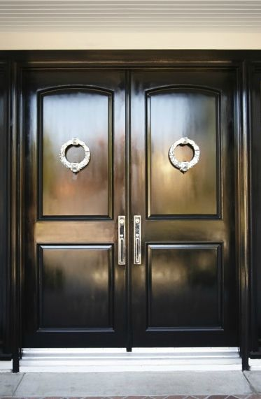 Double glossy black doors and check out those knockers. Best 25  Transitional front doors ideas on Pinterest
