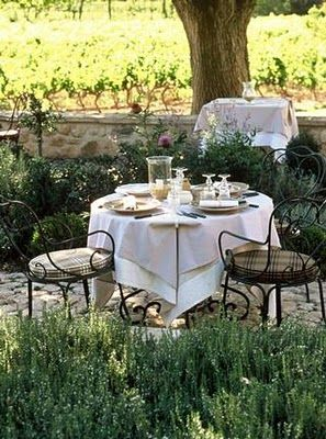 love the idea of a little table next to fragrant rosemary growing and the little stone path