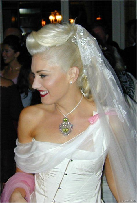 Rock star bride. Gwen Stefani wore her famous platinum locks up in a pompadour-inspired up do when she married Gavin Rossdale in 2002