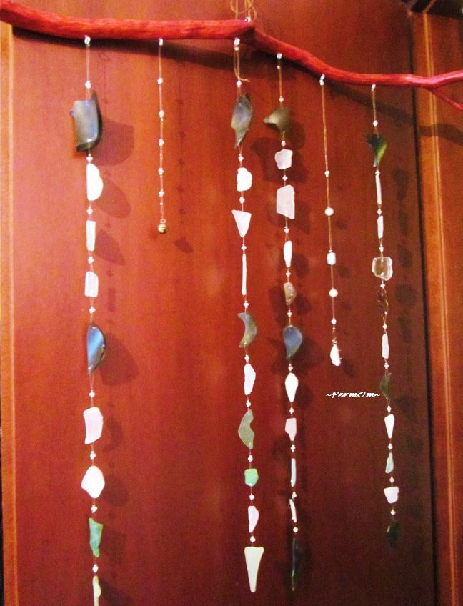 These chimes are made with glasses washed by the Aegean Sea in Greece, crystallic beads, a brass bell, two pearls and a spiral to hold a pumice, in order to help the space flow in the Divine Energy and bring love.The wood is from an olive tree.Amazing energy!!