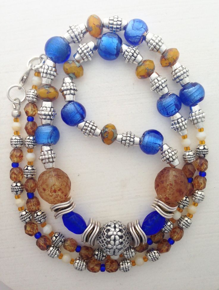 "Beaded necklace in dark blue, burnt orange, ochre, amber, cream, and silver, 28"" by ShereesTrinketBox on Etsy"
