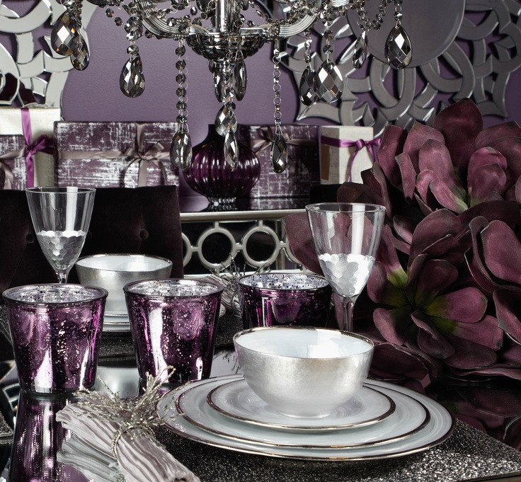 Set an exquisite dining table using regal tones of for Silver centerpieces for dining table