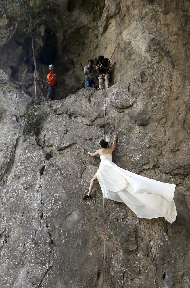 Wedding Photos While Rock Climbing. I'm not sure I'm brave enough to do that, but it's a fun idea.