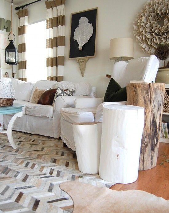 nesting place - living room.  love the cowhide patchwork rug and the tree stump side table