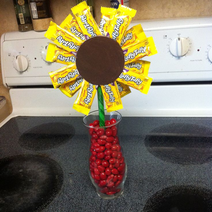 Sunflower candy bouquet! Laffy taffy petals, hard candy stem and Boston baked beans to fill the vase. I painted a wooden circle brown for the center of my sunflower.