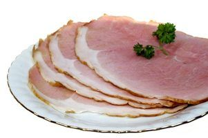 Serve sliced spiral ham at holiday dinner parties.