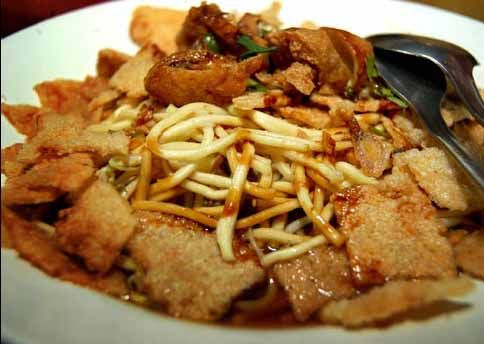 Mie Kopyok, noodle with rice cake, rice cracker and soybean sprout in garlic, chilli and sweet soy sauce (Semarang)