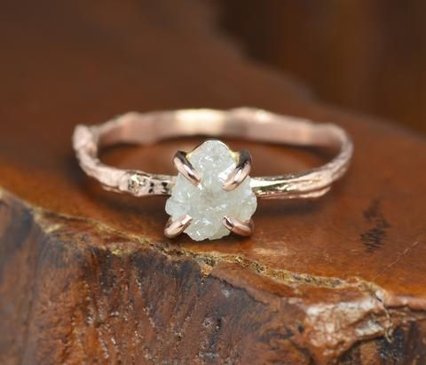 I am 100% in love with this.   Uncut Diamond Branch Rose Gold Engagement RingThis ring features a natural white 1.65 carat rough diamond. The diamond has been set into a low profile hand crafted prong setting. The ring band is cast from an actual tree branch. The nat...