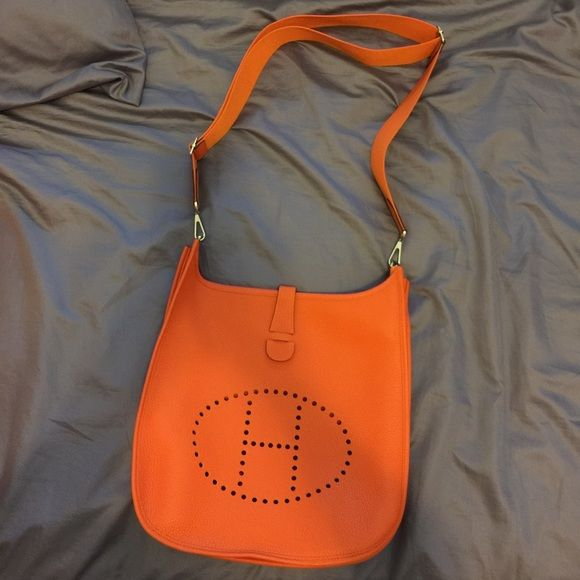 Auth Hermes Evelyne III GM Orange clemence leather Brand new! Authentic Hermes purchased May 2015 from Istanbul stamped T. NO negotiation for purchase on Posh!!!! Only willing to negotiate for in person cash purchase or direct bank transfer. Purchase will include original orange box and two dustbags (bag and strap). Box is slightly dented during transportation. Serious inquiry only please Hermes Bags