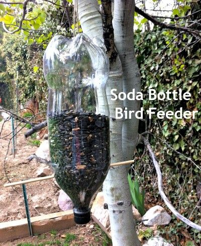 Earth Day Activities for Kids - Soda Bottle Bird Feeder - TodaysMama.com with help from #CuriousGeorgePBS