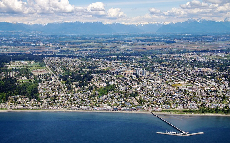 Gorgeous #WhiteRock Aerial Photo - OCEAN VIEWS looking North beyond South Surrey to the farms of Cloverdale & the Fraser Valley