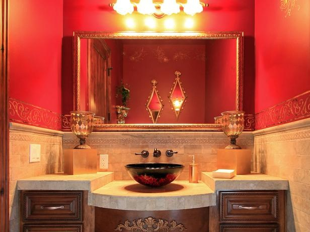 Red Vessel Sink Complements Powder Room Walls