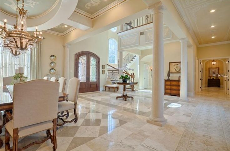 Traditional Entryway with High ceiling, French doors, travertine tile floors, Columns, simple marble tile floors, Balcony