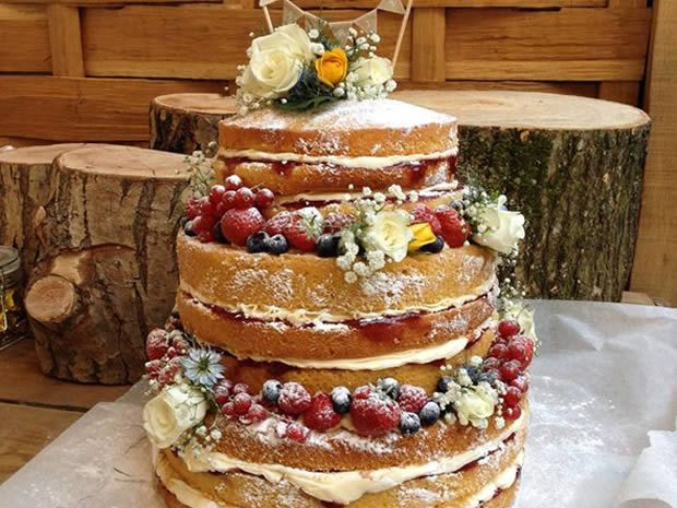 Go for the rustic look with this beautiful cake from Nom Nom Cup Cakery. #weddingcakes #nakedcakes #rusticwedding