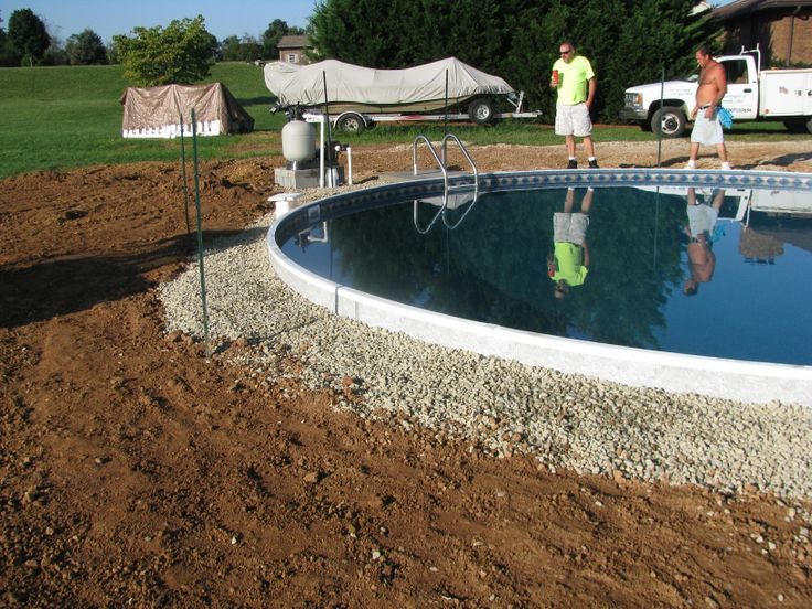 surrounding the radiant pool with stone to complete the back fill