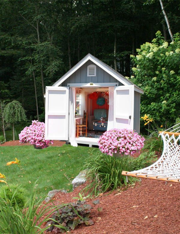 Every bookworm will die for this retreat. Sure, the grey-blue paint color and white doors and trim are fairly tame, but we love the bright pink flower bushes that anchor the entrance.    - HouseBeautiful.com