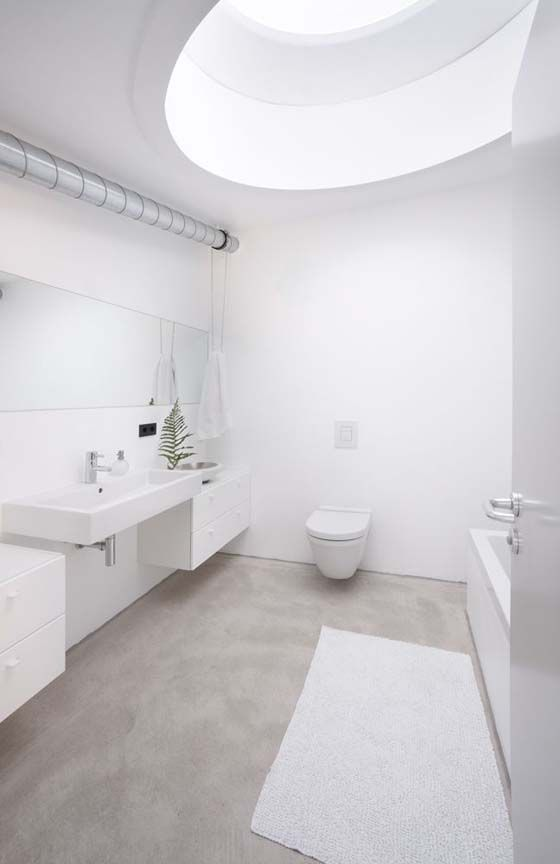 white bathroom with natural concrete floor