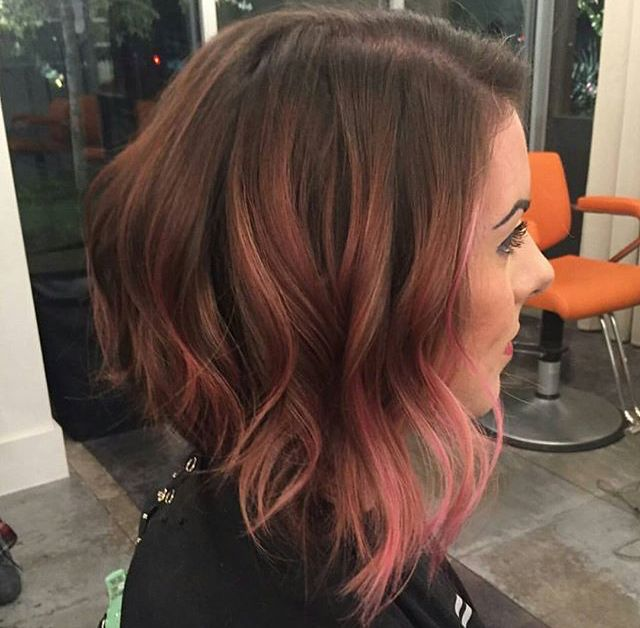 Long angled bob with pink balayage.