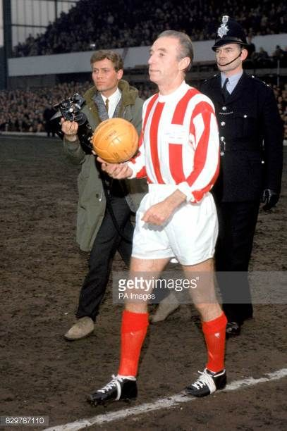 Stoke City's Stanley Matthews walks out onto the pitch before the match