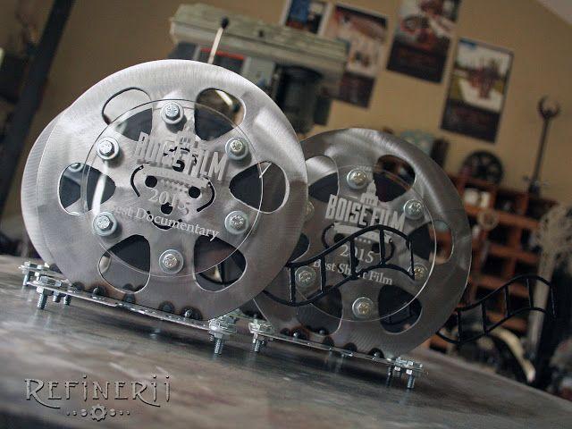 Boise Film Festival trophies made from polished steel.  Custom film reel design www.refinerii.net