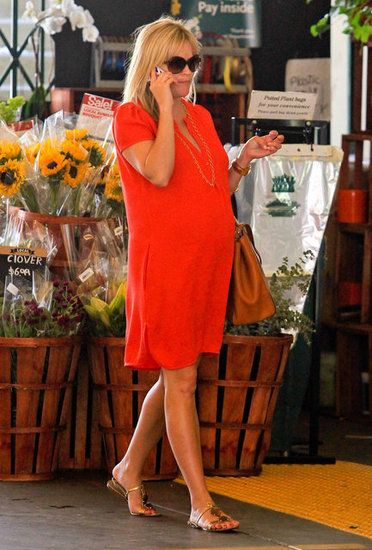 Striking in Red: During a grocery outing, Reese Witherspoon defined casual pregnancy perfection in a red shirtdress, gold sandals, and a simple necklace.