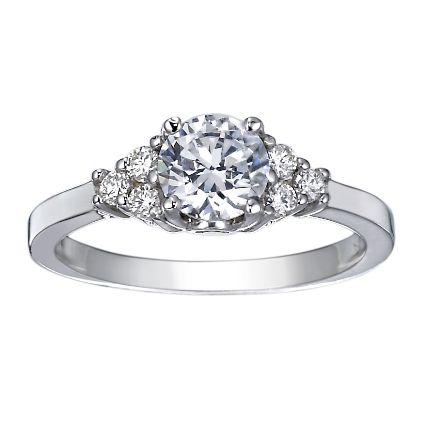 This Ring Features A Brilliant Cluster Of Three Diamonds Framing Each Side The Center Gem