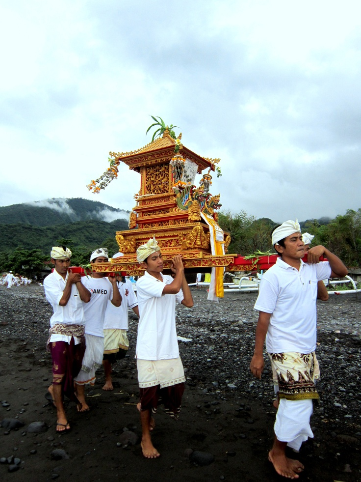 Young men carrying ancestor altars at 'cleansing'' ceremony two days before Nyepi, Amed Bali
