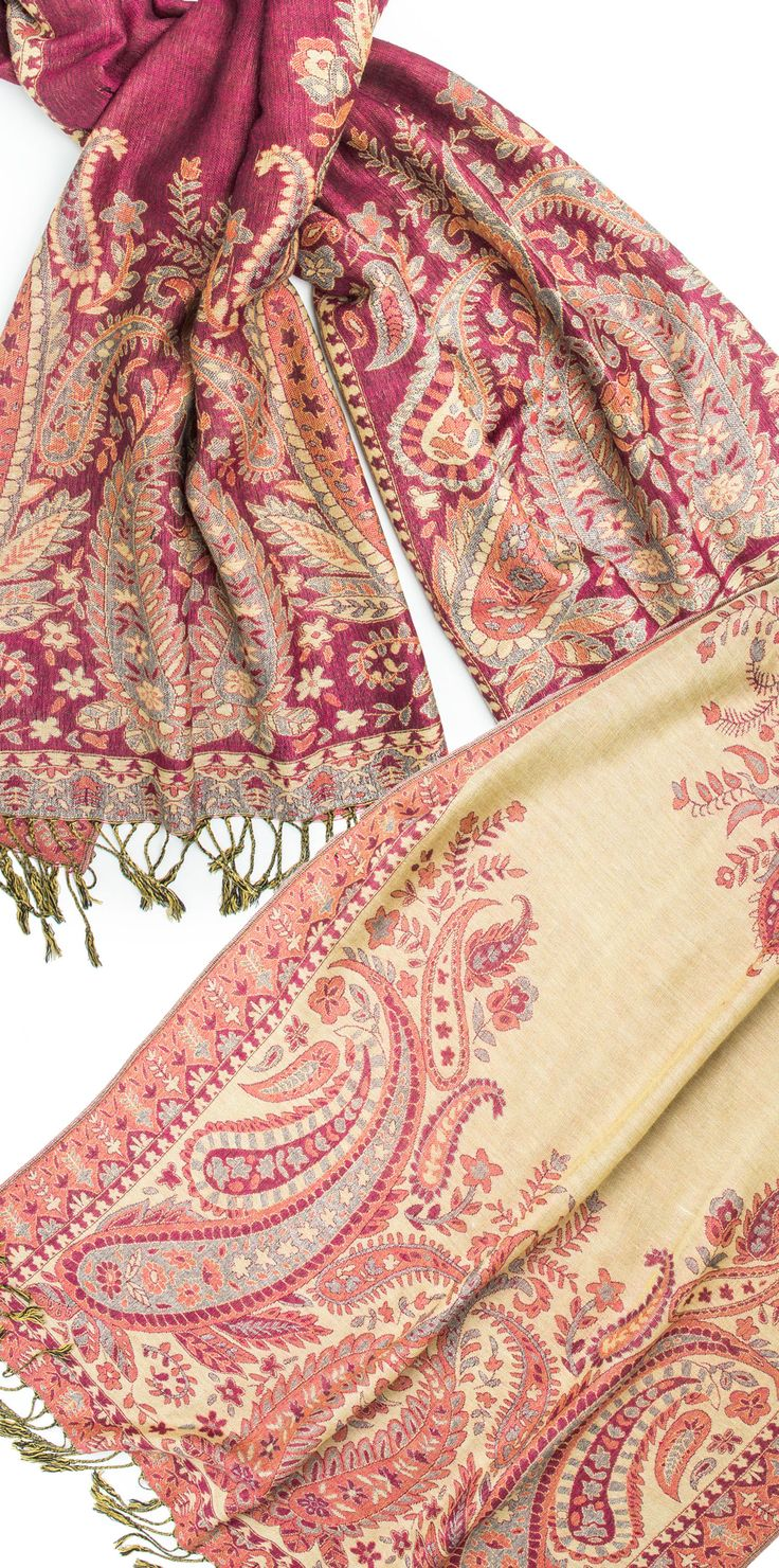 This pashmina scarf worked in shades of raspberry pink,and creamy beige is woven in a gorgeous traditional Indian pattern that is both floral and paisley, and is completely reversible. These colors reveal themselves differently on either side of this paisley floral scarf, creating two color coordinated versions of the paisley pattern -- One scarf 2 personalities! This Viscose scarf has a soft warm feel, a beautiful traditional indian pattern, punctuated by twisted knotted fringe ends.