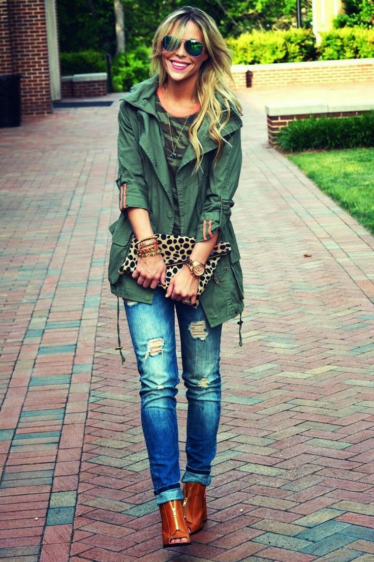 Teal green stylish jacket with teal green and black mix cute blouse and blue denim stylish jeans and leopard leather hand bag and shining brown leather boots