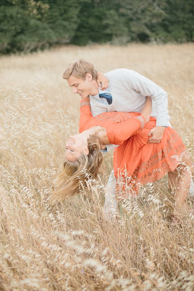 Such a sweet shot of this couple dancing in a field during their engagement shoot by @Kristen Booth - Fairytale Photographer