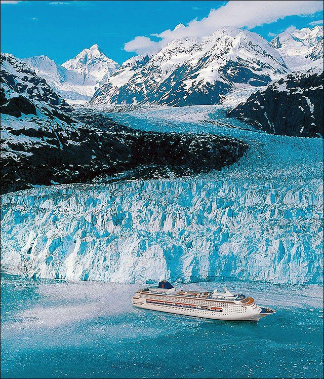 Glacier Bay, Alaska _ An Alaskan cruise is an ideal way to see the state's stunning mountain and glacial vistas. In this photo provided by the Norwegian Cruise Line, the Norwegian Sky cruise ship is dwarfed by the scenic splendor.