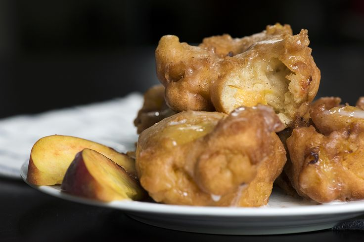 Peach Fritters 20 minutes to prepare serves 8-10 INGREDIENTS 2 fresh peaches, peeled and sliced 2 large eggs 1 cup flour 1/3 cup milk 2 tablespoons brown sugar 1 tablespoon unsalted butter, melted 1 teaspoon baking powder 1 teaspoon salt 1 teaspoon vanilla extract 1/2 teaspoon cinnamon Canola oil, for frying Glaze: 1 cup powdered sugar 3 tablespoons milk