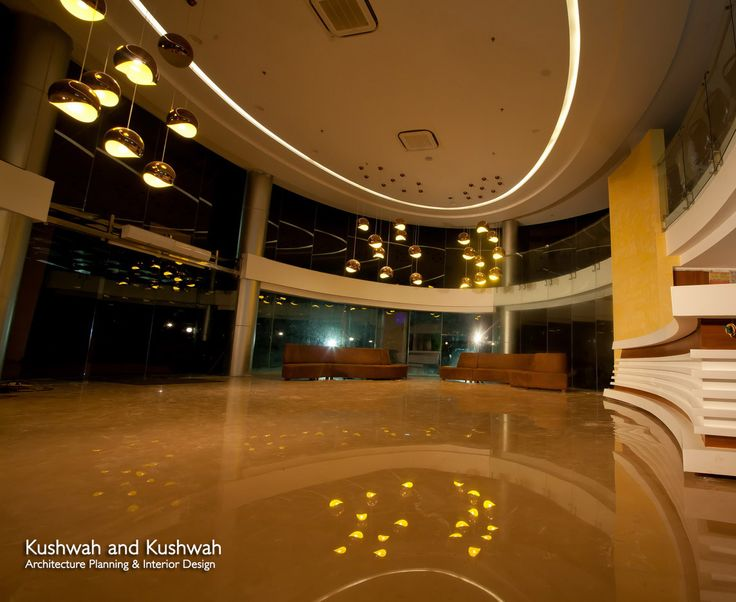 Double Height Entrance Lobby With Copper Yellow Coloured Lights